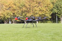 Large aerial unmanned aerial vehicle. The unmanned aerial camera can shoot the scene that the camera can`t take. It is a very convenient shooting device Stock Images