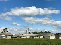 Large agricultural agricultural farm building with equipment, houses, barns, granary stock photo