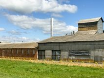 Large agricultural agricultural farm building with equipment, houses, barns, granary stock images