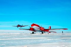 Large aircraft tunes snow on the runway airport. royalty free stock photos