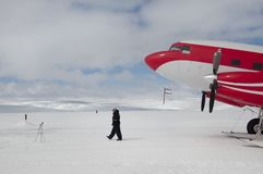 Large aircraft tunes snow on the runway airport. stock photos