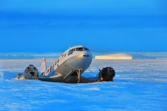 Large aircraft tunes snow on the runway airport. stock photography
