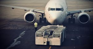 Large aircrafts is preparing to take off photograph. A large white coloured aircrafts is preparing for the departure on the airport ground stock photograph Stock Images