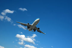 Large airliner. Approaching major airport on a sunny day Stock Images