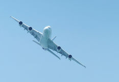 Large airliner flying Stock Photos