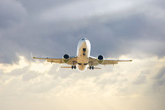 Large airliner flying in sky Stock Image