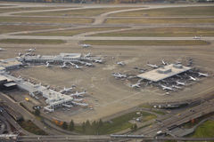 Large Airliner Ramp Area. Aerial view of several airliners parked at major airport terminal Royalty Free Stock Images