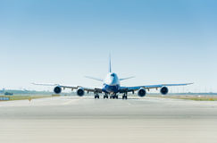 The large airplane on the runway ready for takeoff Royalty Free Stock Photo