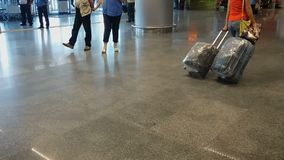 Large airport terminal is never empty, people waiting for arrival and departure. Stock footage stock video
