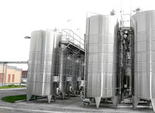 Large aluminum drums tanks and pipelines modern plant for the pr Royalty Free Stock Images