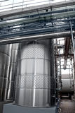 Large aluminum drums tanks and pipelines modern plant for the pr Stock Images