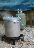 Large aluminum pot with gas canister in the camp kitchen. While preparing the meal Royalty Free Stock Photo