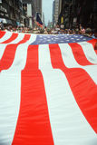 Large American Flag being carried in parade. Large U.S. flag at Desert Storm Victory ticker tape parade, New York City, New York Stock Image