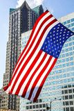 St. Louis, Missouri, United States-July 4th 2014-Large American Flag Waving in Front of Modern Glass Buildings in City Royalty Free Stock Photos