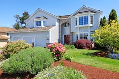 Large American grey house front exterior. Royalty Free Stock Photography