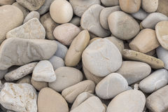 Large amount rounded and polished beach rocks Stock Photography