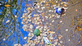 A large amount of trash polluting the river stock footage