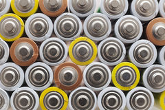Large amount of used AA batteries in several colors Royalty Free Stock Image