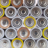 Large amount of used AA batteries in several colors Stock Image