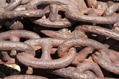 Large anchor chains. Large, antique anchor chains in a pile royalty free stock photo