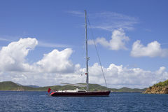 Large anchored sailboat. Large luxurious red sailboat anchored in the virgin islands Royalty Free Stock Photos