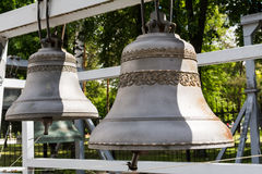 Large ancient brass bells close up. Royalty Free Stock Photography
