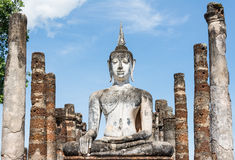 Large ancient white Buddha image and pillars Stock Image