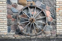 Large ancient wooden cart wheel. royalty free stock photography