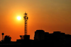 Large antenna with the sunset Stock Images