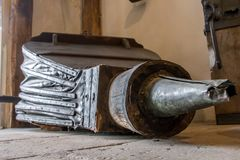 Large antique bellows on floor Royalty Free Stock Image