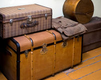 Large antique boxes for storing things stand on the wooden floor.  Royalty Free Stock Photo