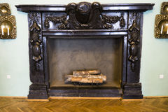 Large antique fireplace Stock Photo