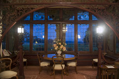 Large antique window. Luxurious interior with dining table, arch and windows Royalty Free Stock Photos