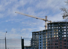 Large apartment buildings construction in winter sunny day royalty free stock images