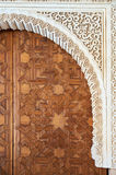 Large arabic style door in precious wood. Alhambra. Detail of wood carving and stone sculpture. Large arabic style door in precious wood. Alhambra, Granada Stock Photo