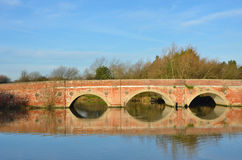 Large arched redbrick river bridge Royalty Free Stock Photo