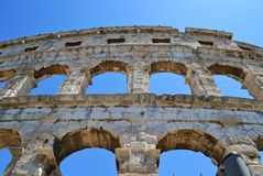 Large arches of the amphitheater in Pula, Croatia. royalty free stock images