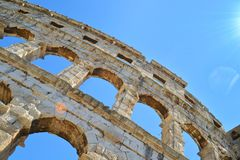Large arches of the amphitheater in Pula stock images