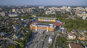 Big arena of football stadium `Geologist` in summer in Tyumen. Large arena football stadium `Geologist` from the height of the summer of 2018 in the city of stock images