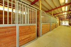 Large arena with horse stables. Horse stables at private covered arena Royalty Free Stock Photos