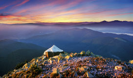 Large army tent. At the top of the mountain to put a large army tent in which they live experts Mining Royalty Free Stock Image