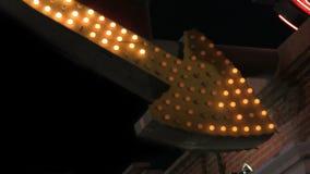 Large arrow sign of light bulbs stock footage