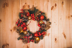 Large artificial circled wreath during Christmas on door Royalty Free Stock Photos