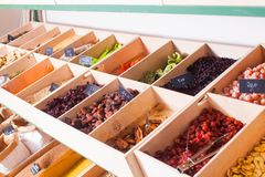 Assortment of multicolored dried fruits in the boxes stock image