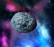 Large asteroid. Flying in the universe Stock Image