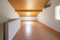 Large attic with wooden floors and exposed beams royalty free stock photo