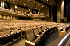 Large auditorium. Large empty auditorium or theater with padded seating great background royalty free stock photo