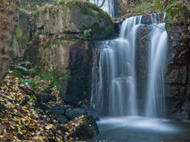 Large autumn waterfall Stock Images