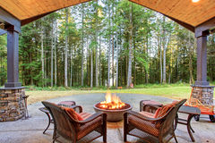 Large back yard with grass. Large back yard with grass and covered patio with firepit Royalty Free Stock Images