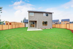 Large back yard with a lot of grass. Stock Photography